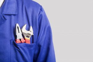 technician-with-tools-in-shirt